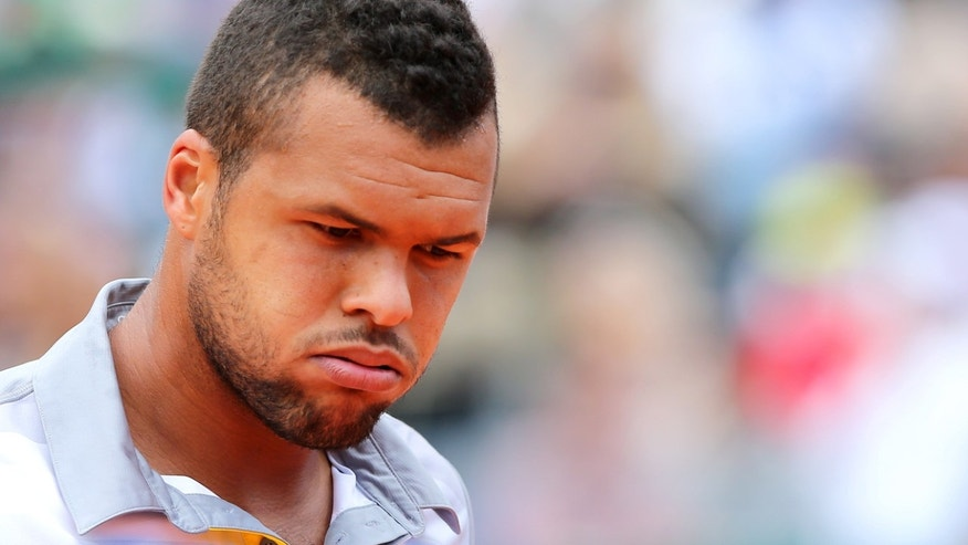France's Jo-Wilfried Tsonga reacts during his semifinal match of the Monte Carlo Tennis Masters tournament in Monaco against Spain's Rafael Nadal, Saturday, April 20, 2013. (AP Photo/Claude Paris)