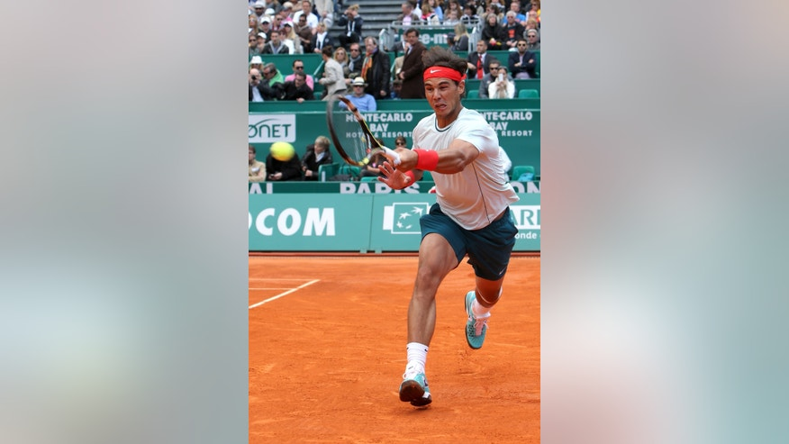 Spain's Rafael Nadal plays a return to France's Jo-Wilfried Tsonga during their semifinal match of the Monte Carlo Tennis Masters tournament in Monaco, Saturday, April 20, 2013. (AP Photo/Claude Paris)