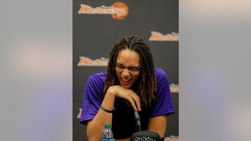 Phoenix Mercury's Brittney Griner, the No. 1 overall pick the WNBA draft, laughs during a news conference Saturday, April 20, 2013,  in Phoenix. (AP Photo/Matt York)