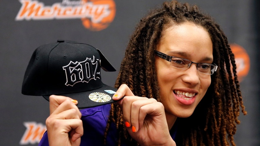 Phoenix Mercury's Brittney Griner, the No. 1 overall pick the WNBA draft, holds up a hat during a news conference Saturday, April 20, 2013,  in Phoenix. (AP Photo/Matt York)