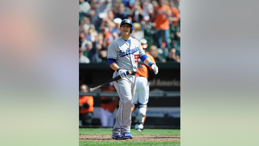 Los Angeles Dodgers Ramon Hernandez reacts after striking out with the bases loaded against the Baltimore Orioles in the fifth inning of the first baseball game of a doubleheader Saturday, April 20, 2013, in Baltimore. (AP Photo/Gail Burton)