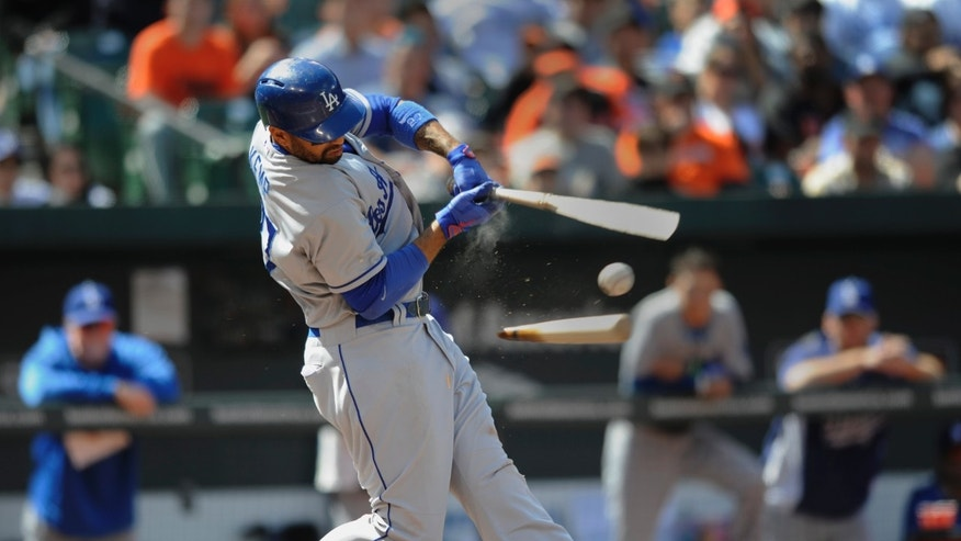 Los Angeles Dodgers Matt Kemp follows through on a broken bat single against the Baltimore Orioles in the seventh inning in the first baseball game of a doubleheader Saturday, April 20, 2013, in Baltimore. (AP Photo/Gail Burton)