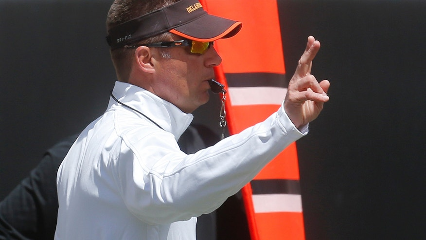 Oklahoma State coach Mike Gundy gestures during the NCAA college football team's spring game in Stillwater, Okla., Saturday, April 20, 2013. (AP Photo/Sue Ogrocki)