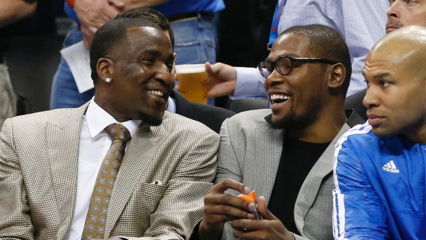 Oklahoma City Thunder center Kendrick Perkins, left, and forward Kevin Durant, center, laugh as they watch the first quarter of an NBA basketball game between the Thunder and the Milwaukee Bucks in Oklahoma City, Wednesday, April 17, 2013. Thunder guard Derek Fisher sits at right. (AP Photo/Sue Ogrocki)