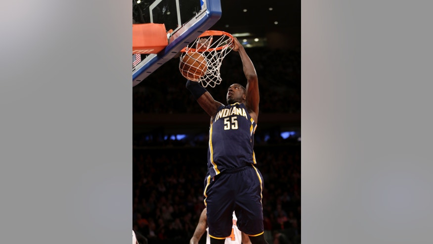 Indiana Pacers' Roy Hibbert slams the ball during the first half of the NBA basketball game against the New York Knicks, Sunday, April 14, 2013, in New York. (AP Photo/Seth Wenig)