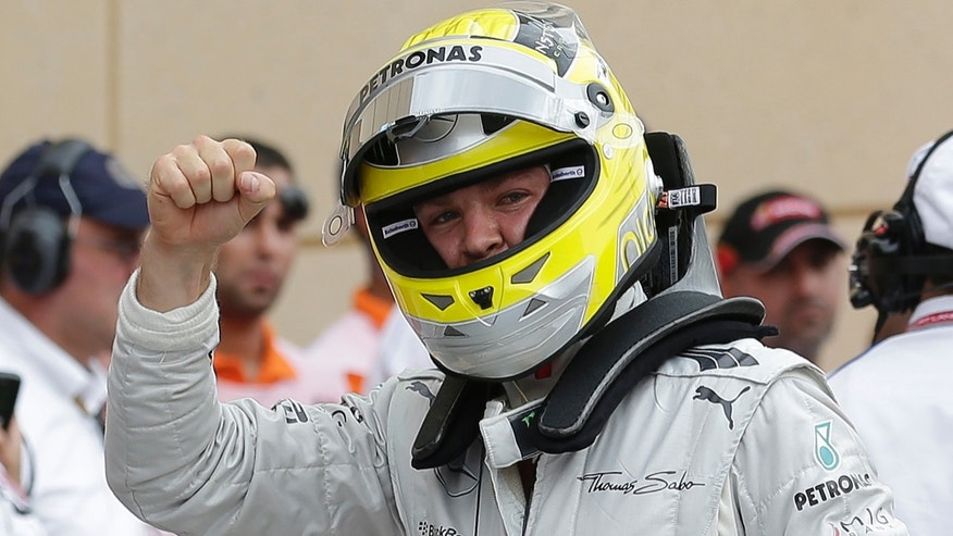 Mercedes driver Nico Rosberg of Germany gestures after claiming pole position after the qualifying session ahead of the Bahrain Formula One Grand Prix at the Formula One Bahrain International Circuit in Sakhir, Bahrain, Saturday, April 20, 2013. The Bahrain Formula One Grand Prix will take place on Sunday. (AP Photo/Hassan Ammar)