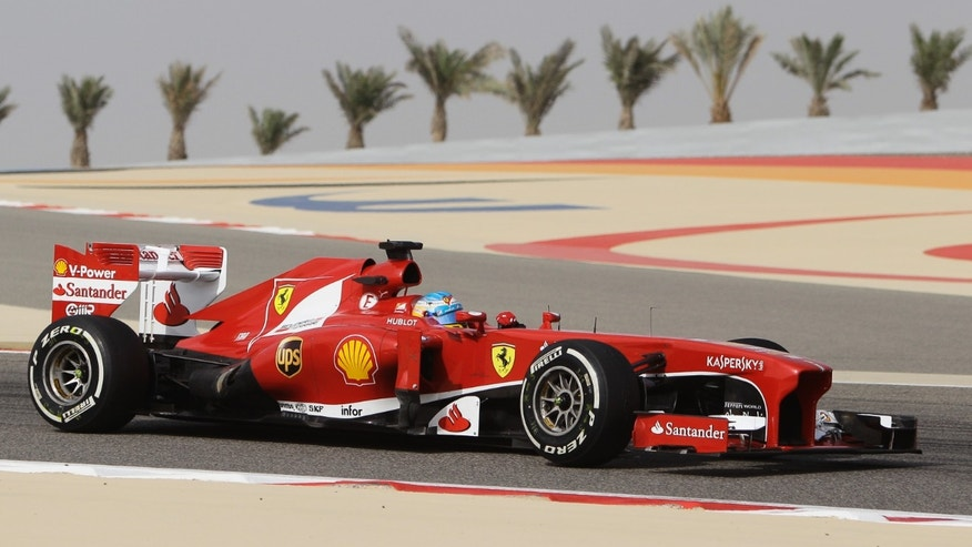 Ferrari driver Fernando Alonso from Spain steers his car during the second practice session of Bahrain Formula One Grand Prix at the Bahrain International Circuit in Sakhir, Bahrain, Friday, April 19, 2013. The Bahrain Formula One Grand Prix will take place on Sunday. (AP Photo/Kamran Jebreili)