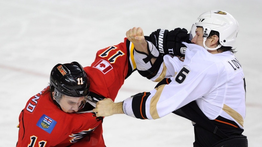 Anaheim Ducks' Ben Lovejoy, right, briefly fights with Calgary Flames' Mikael Backlund, from Sweden, during first period NHL action in Calgary, Alberta, Friday, April 19, 2013.  (AP Photo/The Canadian Press, Larry MacDougal)