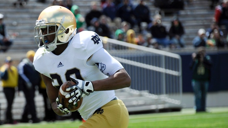 Notre Dame's CJ Prosise makes a catch for a touchdown during the Blue-Gold spring NCAA college football game, Saturday, April 20, 2013, in South Bend, Ind. (AP Photo/Joe Raymond)