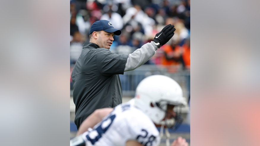 Penn State head coach Bill O'Brien gives direction as the team warms up for their spring NCAA college football game on Saturday, April 20, 2013, in State College, Pa. (AP Photo/Keith Srakocic)