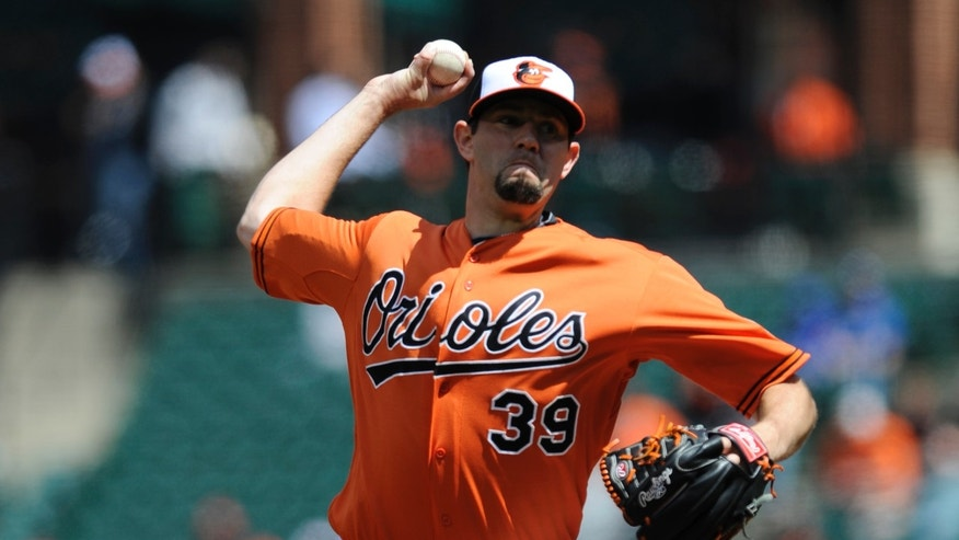 Baltimore Orioles pitcher Jason Hammel delivers against the Los Angeles Dodgers during the first inning in the first baseball game of a doubleheader Saturday, April 20, 2013, in Baltimore. (AP Photo/Gail Burton)