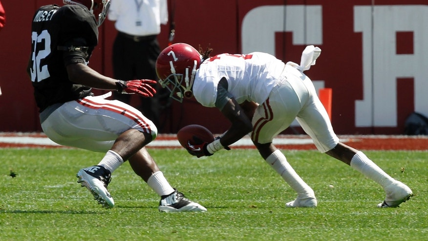 Receiver Kenny Bell (7) catches a pass as CJ Mosley (32) defends during the Alabama spring NCAA college football game in Tuscaloosa, Ala., Saturday, April 20, 2013. (AP Photo/Butch Dill)