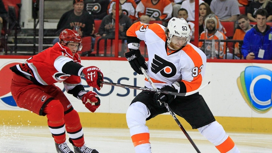 Philadelphia Flyers' Jakub Voracek, right, of the Czech Republic,  breaks away from Carolina Hurricanes' Eric Staal for a shot during the first period of an NHL hockey game, Saturday, April 20, 2013, in Raleigh, N.C. (AP Photo/Karl B DeBlaker)