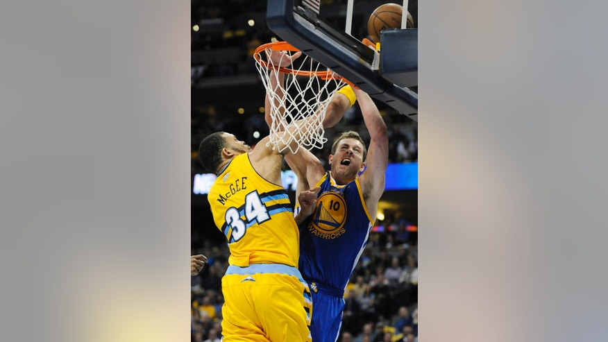 Denver Nuggets center JaVale McGee, left, blocks a shot by Golden State Warriors forward David Lee, right, in the second quarter of Game 1 in the first round of the NBA basketball playoffs on Saturday, April 20, 2013, in Denver. (AP Photo/Chris Schneider)