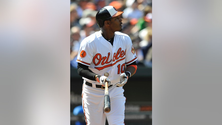 Baltimore Oriole's Adam Jones watches his solo home run leave the field against the Los Angeles Dodgers in the third inning of a baseball game Sunday, April 21, 2013 in Baltimore. (AP Photo/Gail Burton)