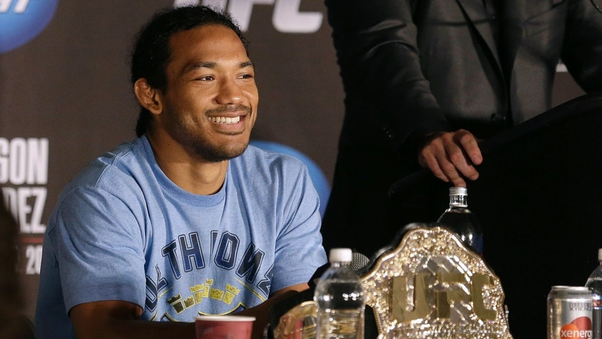 Benson Henderson smiles during a news conference after beating Gilbert Melendez in a UFC lightweight championship mixed martial arts fight in San Jose, Calif., Saturday, April 20, 2013. Henderson won by split decision to retain the championship. (AP Photo/Thomas Mendoza)