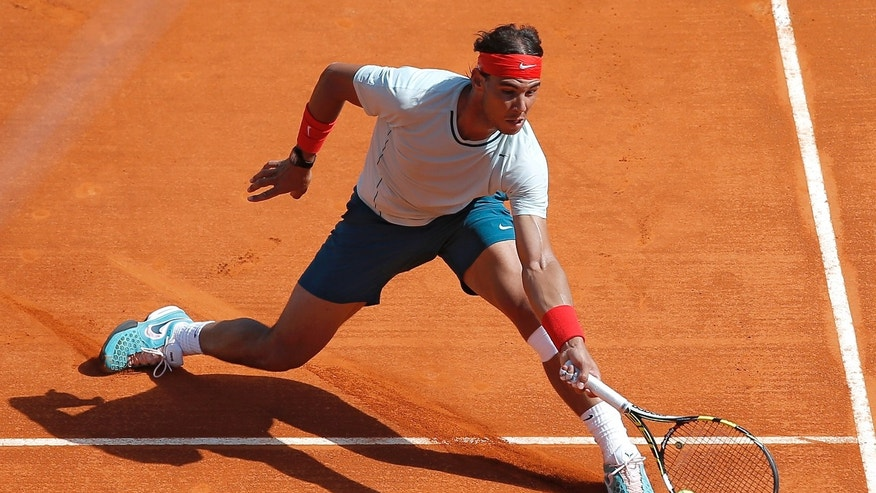 Spain's Rafael Nadal plays a return to Novak Djokovic of Serbia during their final match of the Monte Carlo Tennis Masters tournament in Monaco, Sunday, April 21, 2013. (AP Photo/Lionel Cironneau)