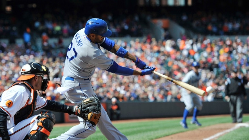 Los Angeles Dodgers Matt Kemp connects for a RBI single against the Baltimore Orioles in the fifth inning of an MLB interleague baseball game Sunday, April 21, 2013 in Baltimore. (AP Photo/Gail Burton)