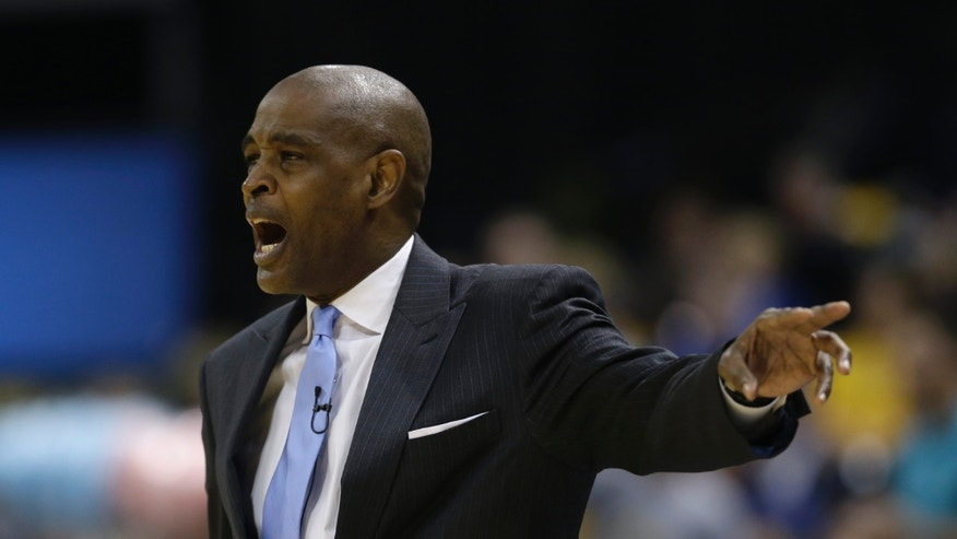 Atlanta Hawks head coach Larry Drew shouts instructions during the first half of Game 1 in the first round of the NBA basketball playoffs against the Indiana Pacers, Sunday, April 21, 2013, in Indianapolis. (AP Photo/Darron Cummings)