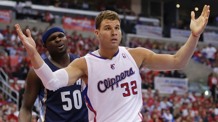 Los Angeles Clippers forward Blake Griffin, right, and Memphis Grizzlies forward Zach Randolph both react after getting called for a foul on the same play during the second half of Game 1 of a first-round NBA basketball playoff series Los Angeles, Saturday, April 20, 2013. (AP Photo/Chris Carlson)