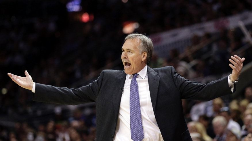 Los Angeles Lakers head coach Mike D'Antoni reacts to a call during the second half of Game 1 of their first-round NBA basketball playoff series against the San Antonio Spurs, Sunday, April 21, 2013, in San Antonio. San Antonio won 91-79. (AP Photo/Eric Gay)
