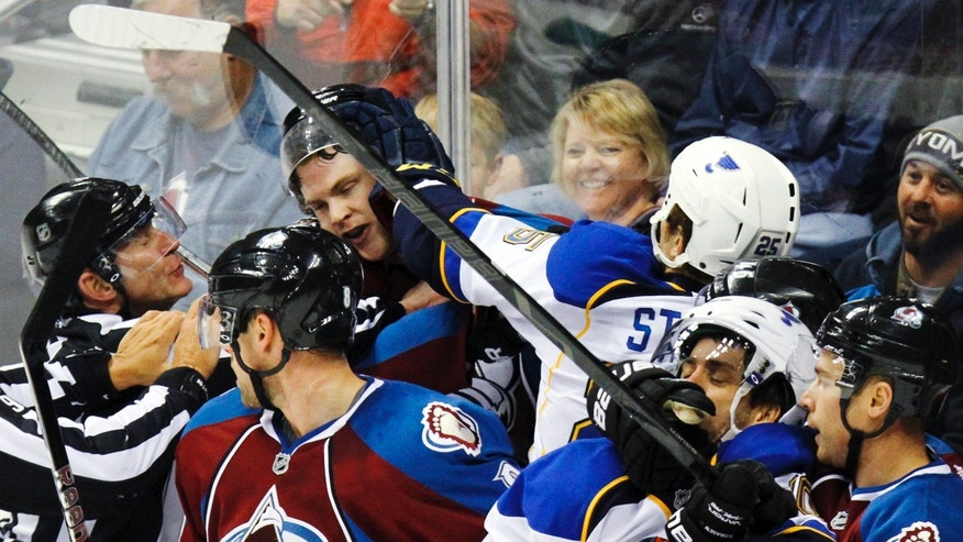 Colorado Avalanche's Jamie McGinn, third from left, is shoved by St. Louis Blues' Chris Stewart (25) during the first period of an NHL hockey game, Sunday, April 21, 2013, in Denver. (AP Photo/Barry Gutierrez)