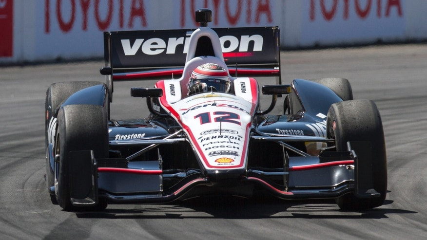 Will Power, of Australia, drives during qualifying at the IndyCar Grand Prix of Long Beach auto race Saturday, April 20, 2013, in Long Beach, Calif. Power qualified in third place. (AP Photo/Ringo H.W. Chiu)