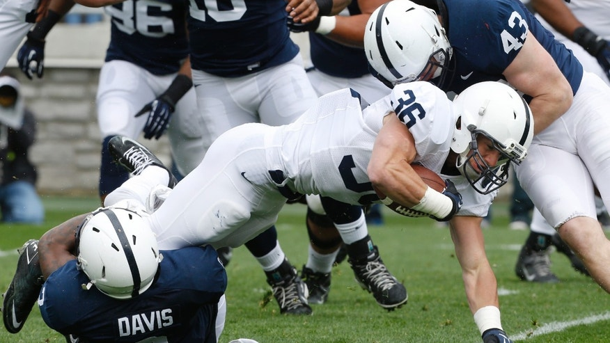 Penn State running back Deron Thompson (36) is tackled by Penn State cornerback Adrian Amos (4) and  linebacker Mike Hull (43) in the first half of their spring NCAA college football game on Saturday, April 20, 2013, in State College, Pa. (AP Photo/Keith Srakocic)