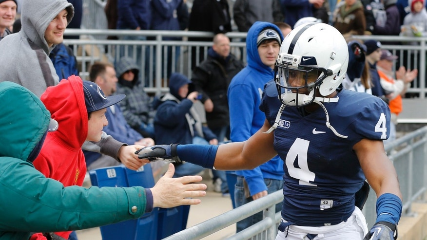 Penn State cornerback Adrian Amos (4) greets fans before the start of their spring NCAA college football game on Saturday, April 20, 2013, in State College, Pa. (AP Photo/Keith Srakocic)