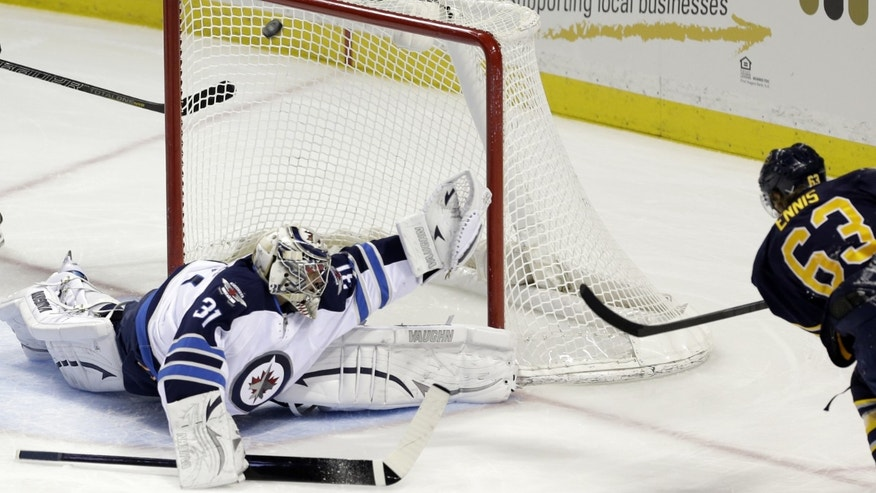 Buffalo Sabres' Tyler Ennis (63) shoots on Winnipeg Jets goalie Ondrej Pavelec, of Czech Republic, during the first period of an NHL hockey game in Buffalo, N.Y., Monday, April 22, 2013. (AP Photo/David Duprey)