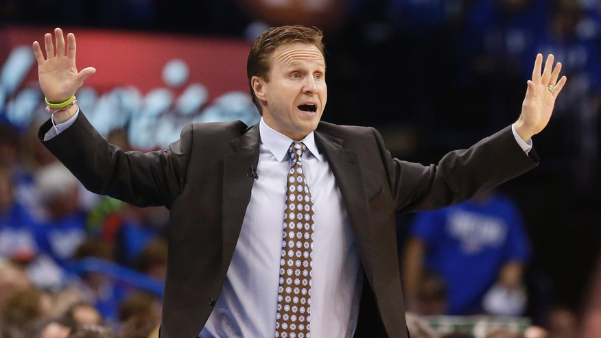 Oklahoma City Thunder head coach Scott Brooks gestures during the first quarter of Game 1 of a first-round NBA basketball playoff series against the Houston Rockets in Oklahoma City, Sunday, April 21, 2013. (AP Photo/Sue Ogrocki)