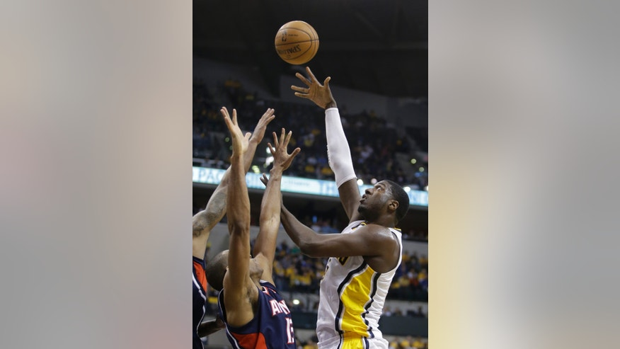 Indiana Pacers' Roy Hibbert shoots against Atlanta Hawks' Al Horford during the second half of Game 1 in the first round of the NBA basketball playoffs on Sunday, April 21, 2013, in Indianapolis. Indiana defeated Atlanta 107-90. (AP Photo/Darron Cummings)