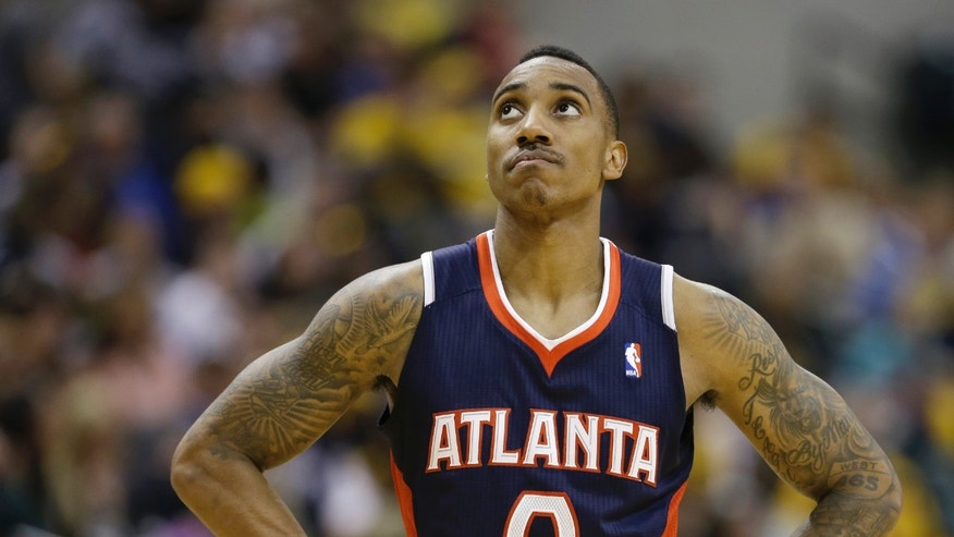 Atlanta Hawks' Jeff Teague looks at the scoreboard late in the second half of Game 1 in the first round of the NBA basketball playoffs against the Indiana Pacers, Sunday, April 21, 2013, in Indianapolis. Indiana defeated Atlanta 107-90. (AP Photo/Darron Cummings)
