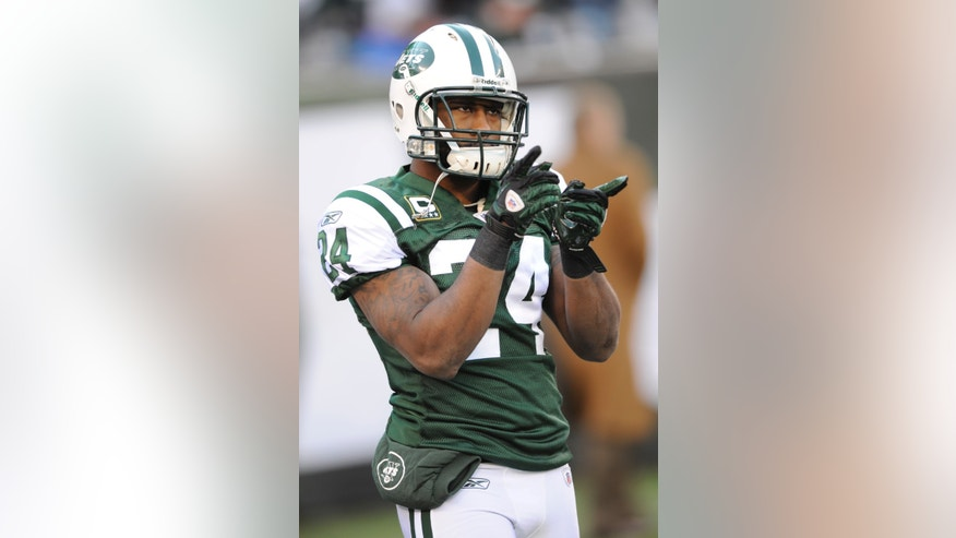 File-This Dec. 24, 2011 file photo shows New York Jets' Darrelle Revis pointing before an NFL football game between the New York Giants and the New York Jets in East Rutherford, N.J.  The Jets have traded Revis to the Buccaneers for this year's No. 13 overall draft pick and another selection next year.  (AP Photo/Bill Kostroun, File)
