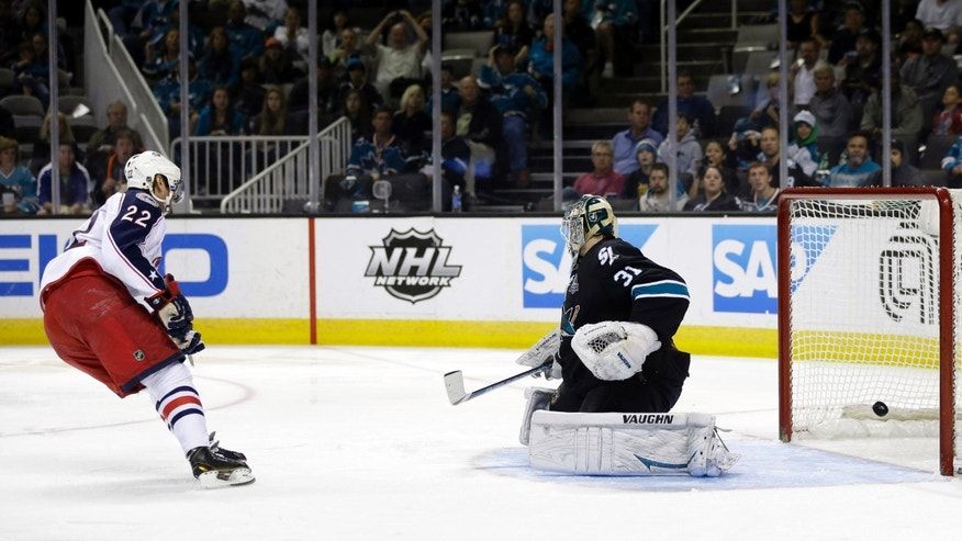 Columbus Blue Jackets center Vinny Prospal (22) scores past San Jose Sharks goalie Antti Niemi, of Finland, during the second period of an NHL hockey game in San Jose, Calif., Sunday, April 21, 2013. (AP Photo/Marcio Jose Sanchez)