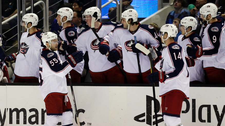 Columbus Blue Jackets center Mark Letestu (55) celebrates his goal with teammates during the first period of an NHL hockey game against the San Jose Sharks in San Jose, Calif., Sunday, April 21, 2013. (AP Photo/Marcio Jose Sanchez)