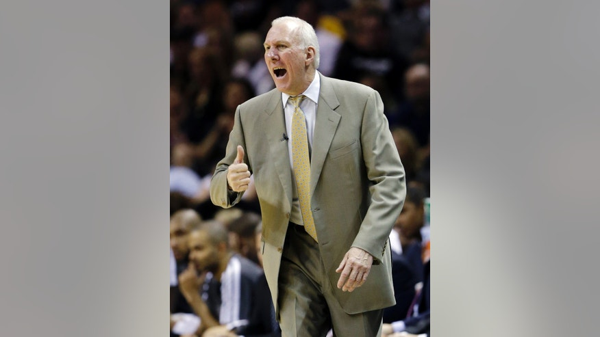San Antonio Spurs head coach Gregg Popovich gives instructions to his players during the second half of Game 1 of their first-round NBA basketball playoff series against the Los Angeles Lakers, Sunday, April 21, 2013, in San Antonio. San Antonio won 91-79. (AP Photo/Eric Gay)