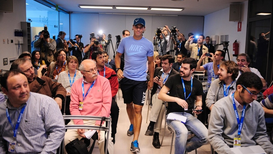 Rafael Nadal of Spain arrives for a press conference during the Barcelona open tennis in Barcelona, Spain, Monday, April 22, 2013. (AP Photo/Manu Fernandez)