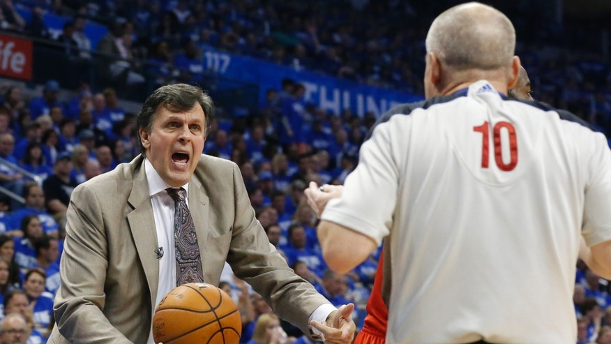 Houston Rockets head coach Kevin McHale, left, questions official Ron Garretson (10) about a call in the third quarter of Game 1 of a first-round NBA basketball playoff series against the Oklahoma City Thunder in Oklahoma City, Sunday, April 21, 2013. Oklahoma City won 120-91. (AP Photo/Sue Ogrocki)