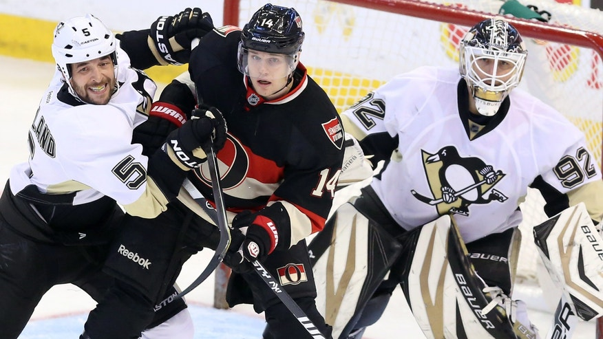 Pittsburg Penguins' Deryk Engelland (5) pushes Ottawa Senators' Colin Greening (14) in front of Penguins goaltender Tomas Vokoun (92) during the second period of their NHL hockey game in Ottawa, Ontario, Monday, April 22, 2013. (AP Photo/The Canadian Press, Fred Chartrand)