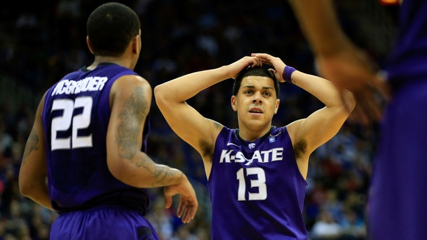 KANSAS CITY, MO - MARCH 16: Angel Rodriguez #13 of the Kansas State Wildcats and teammate Rodney McGruder #22 react in the second half of the game against the Kansas Jayhawks during the Final of the Big 12 basketball tournament at Sprint Center on March 16, 2013 in Kansas City, Missouri.  (Photo by Jamie Squire/Getty Images)