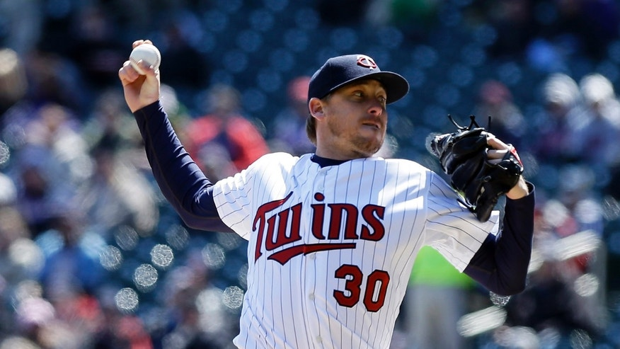 Minnesota Twins starting pitcher Kevin Correia throws against the Miami Marlins in the first inning of the first baseball game of a day/night doubleheader Tuesday, April 23, 2013 in Minneapolis. (AP Photo/Jim Mone)