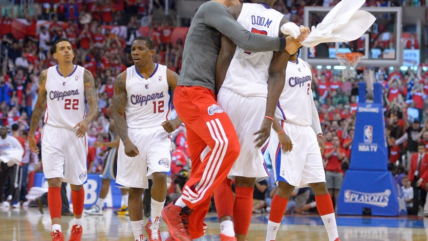 Los Angeles Clippers forward Blake Griffin celebrates with Lamar Odom during the second half of Game 2 against the Memphis Grizzlies of a first-round NBA basketball playoff series, Monday, April 22, 2013, in Los Angeles.  (AP Photo/Mark J. Terrill)