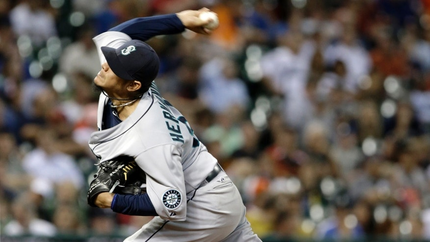 Seattle Mariners' Felix Hernandez delivers a pitch against the Houston Astros in the sixth inning of a baseball game Monday, April 22, 2013, in Houston. Hernandez pitched six scoreless innings. (AP Photo/Pat Sullivan)