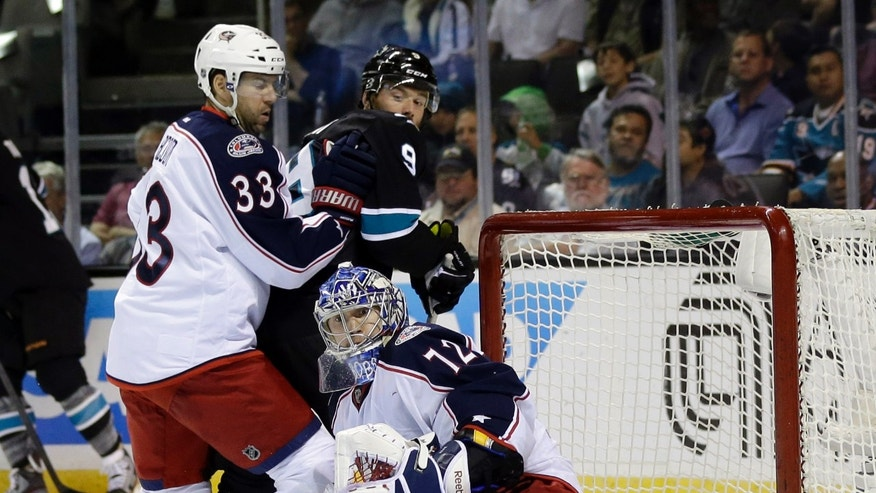 Columbus Blue Jackets goalie Sergei Bobrovsky, of Russia, center, deflects a shot on goal next to teammate Adrian Aucoin (33) and San Jose Sharks left wing Martin Havlat (9), of the Czech Republic, during the first period of an NHL hockey game in San Jose, Calif., Sunday, April 21, 2013. (AP Photo/Marcio Jose Sanchez)