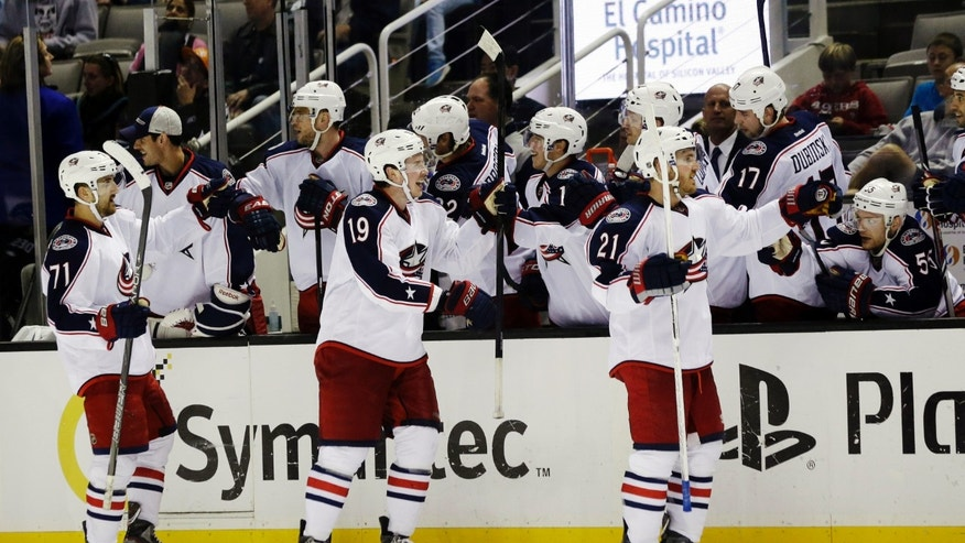 Columbus Blue Jackets center Ryan Johansen (19) celebrates with teammates after scoring the go-ahead goal against the San Jose Sharks during the third period of an NHL hockey game in San Jose, Calif., Sunday, April 21, 2013. Columbus won 4-3. (AP Photo/Marcio Jose Sanchez)