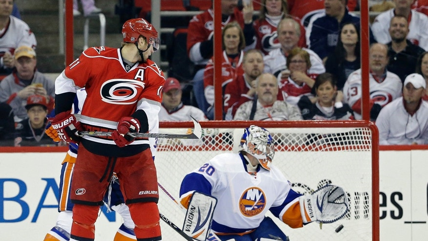 New York Islanders goalie Evgeni Nabokov (20) of Kazakhstan, watches a goal by Carolina Hurricanes' Jordan Staal (11) during the first period of an NHL hockey game in Raleigh, N.C., Tuesday, April 23, 2013. (AP Photo/Gerry Broome)