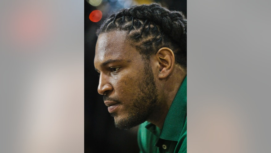 "Jarvis Jones, the top 2013 NFL draft prospect from Georgia, listens during an interview after Subway unveiled a food statue in is likeness and gave him the chain's ""Famous Fan"" title on Tuesday, April 23, 2013 in New York.   (AP Photo/Bebeto Matthews)"