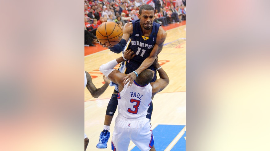 Memphis Grizzlies guard Mike Conley, top, goes to the basket over Los Angeles Clippers guard Chris Paul during the first half of Game 2 of a first-round NBA basketball playoff series, Monday, April 22, 2013, in Los Angeles.  (AP Photo/Mark J. Terrill)