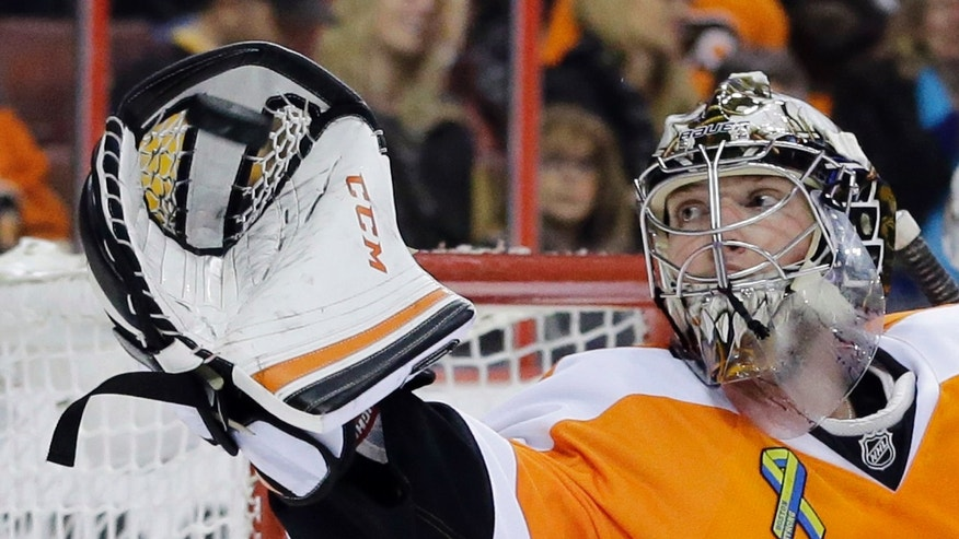 Philadelphia Flyers goalie Steve Mason catches a shot by the Boston Bruins during the first period of an NHL hockey game, Tuesday, April 23, 2013, in Philadelphia. (AP Photo/Matt Slocum)